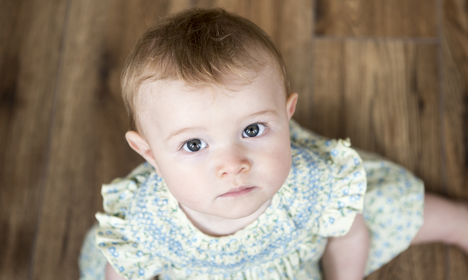 Oh, how time passes – I was invited to photograph Maisie at 6 months old.